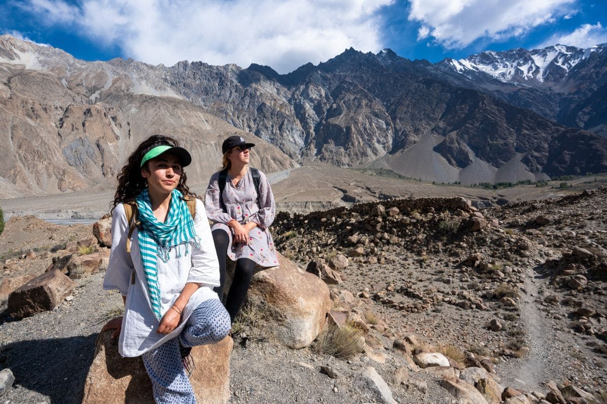 Female tour guide with foreign tourist in Hunza Gilgit Baltistan