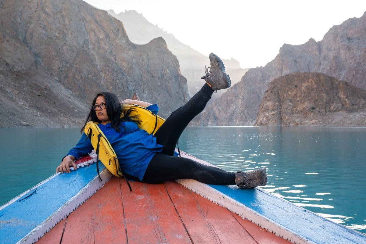 Female tourist boating at Attabad lake in Hunza Gilgit Baltistan 1