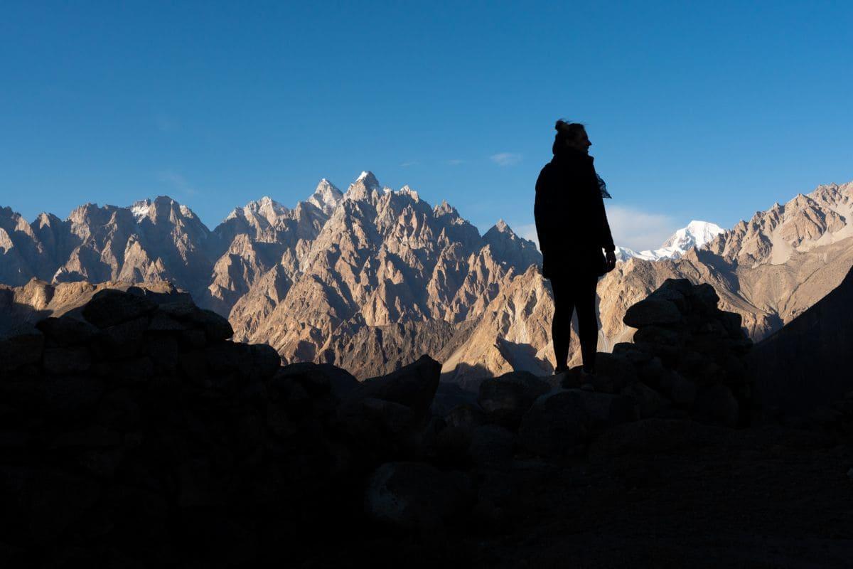 Female tourist in front of Passu cones in Hunza Gilgit Baltistan 1