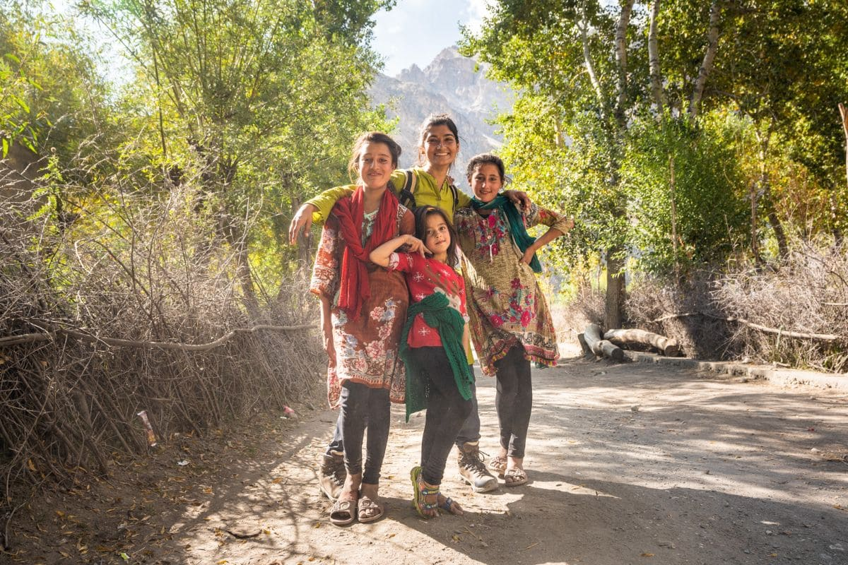 Female tourist with local kids in Ghizer Gilgit Baltistan