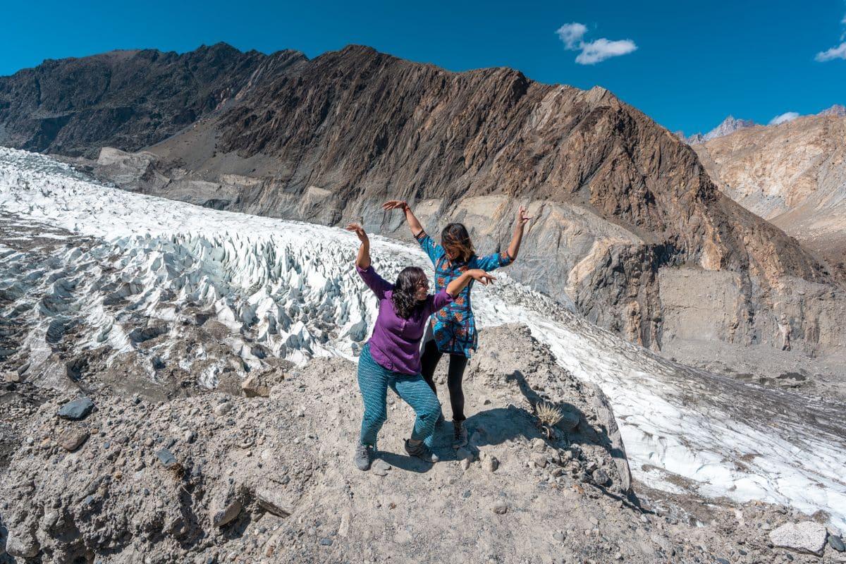 Female tourists at white glacier in Hunza Gilgit Baltistan