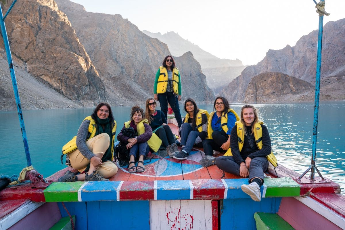 Female tourists boating at Attabad lake in Hunza Gilgit Baltistan