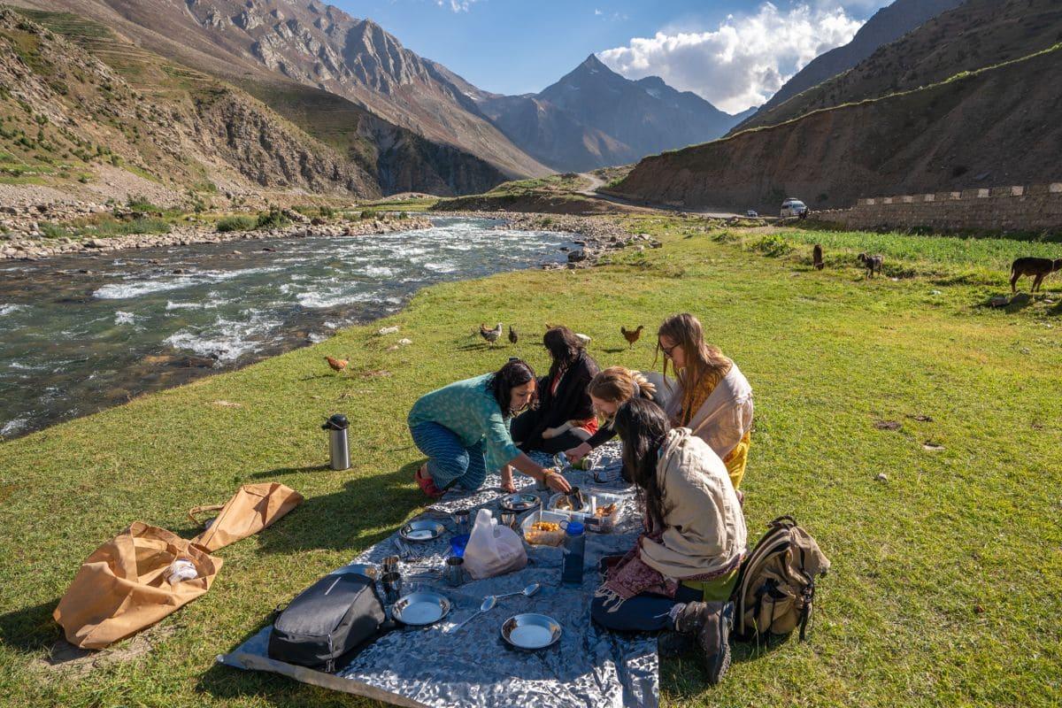 Female tourists having picnic near Naran