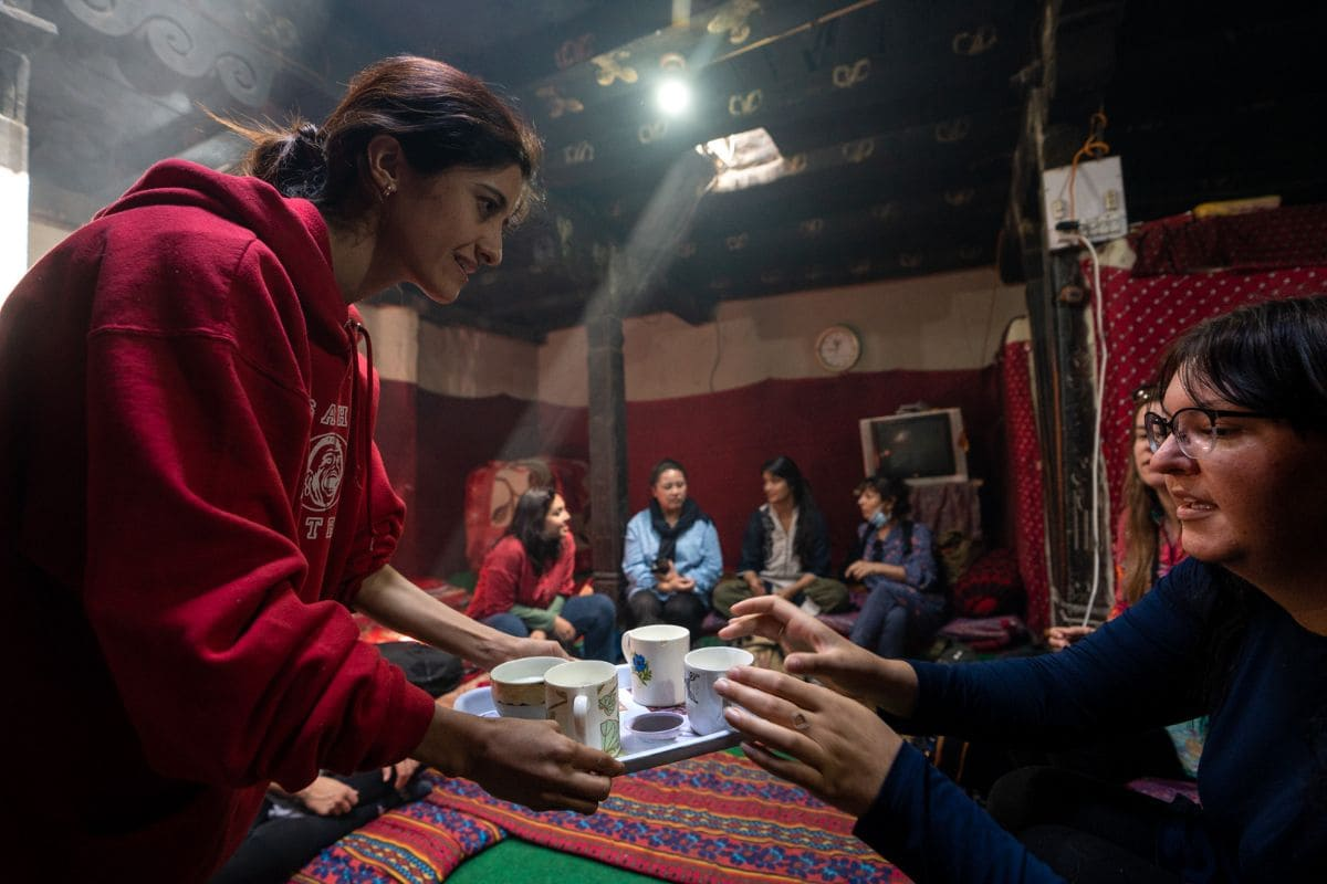 Foreign female tourists in a traditional home in Gilgit Baltistan