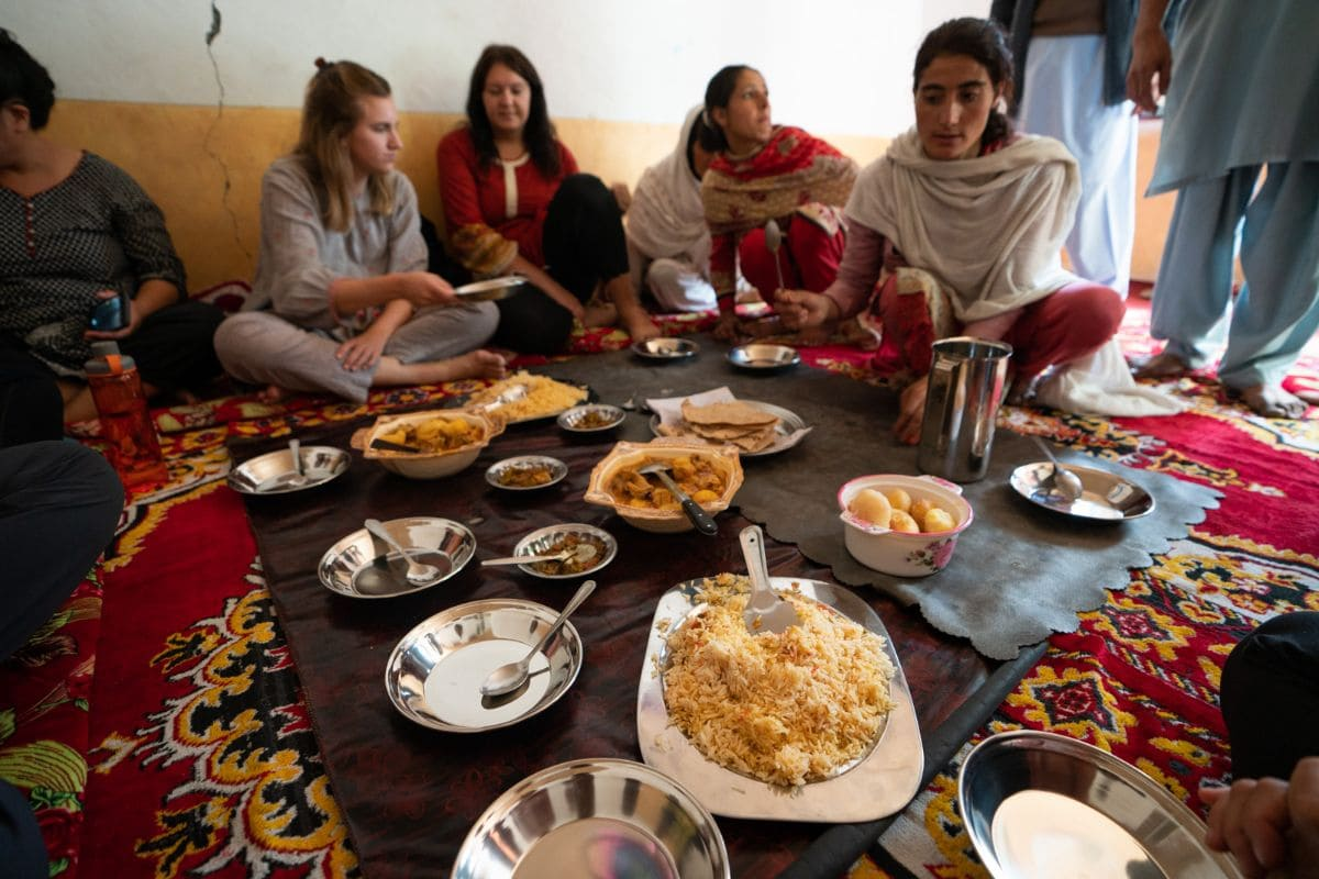 Tourists enjoying traditional lunch in Gilgit Baltistan