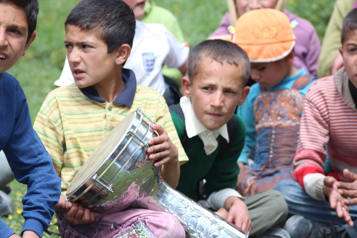 local kids playing music in Hunza